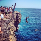 Chris floatin a gainer off the cliff.